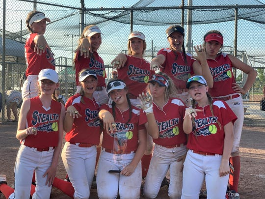 The South Lyon Stealth 14U softball team poses after winning USSSA State Championship.