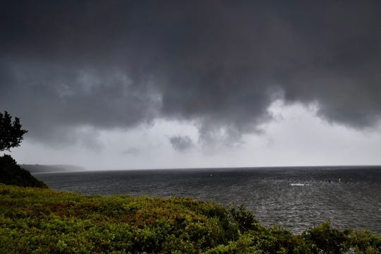 Storm clouds loom over Escambia Bay earlier this week. Tropical Storm Barry is churning in the Gulf of Mexico and is expected to bring dangerously high surf and heavy rain to the Pensacola area.