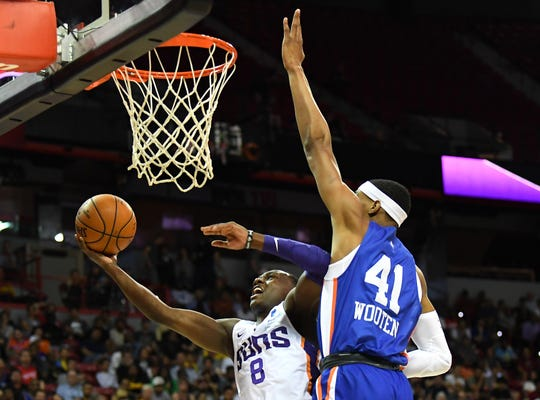 Jul 7, 2019: Phoenix Suns guard Jared Harper (8) shoots defended by New York Knicks forward Kenny Wooten (41) during the first half of an NBA Summer League game at Thomas & Mack Center.
