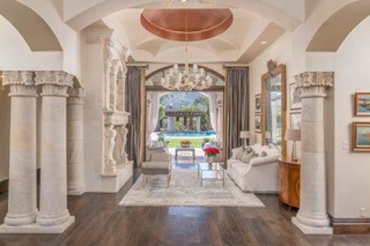 The $4.25M Paradise Valley mansion, sold by Gregory and Sandra Walton, has design features that includes arched doorways and column pillars.