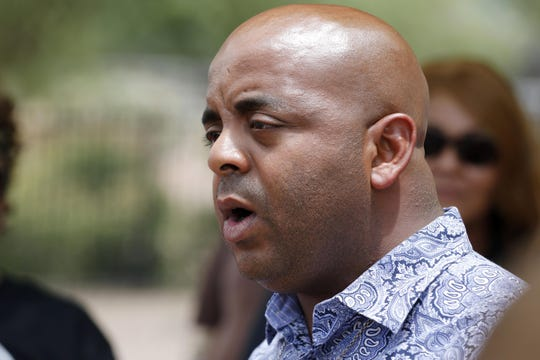 The Rev. Jarrett Maupin talks to the media as he and his followers gather to protest the police at Tempe Beach Park in Tempe on Thursday, July 11, 2019.