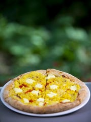 Sweet corn, ricotta, parmigiano reggiano, and calabrian chiles pizza at Fellow Osteria in Scottsdale