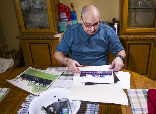 Jim Boerner, a U.S. Air Force veteran, may lose his Mesa home over a problem with his property tax payment. He looks through photos of his time in the military July 8, 2019.