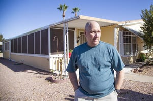 Jim Boerner, a U.S. Air Force veteran, may lose his Mesa home over a problem with his property tax payment. He poses outside his home July 8, 2019.