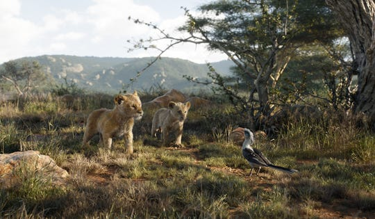 "A young Simba (JD McCrary) and young Nala (Shahadi Wright Joseph) try to distract Zazu (John Oliver) in 2019's ""The Lion King."""