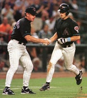 Arizona Diamondbacks' Jay Bell (R) is congratulated by third base coach Brian Butterfield after he hit his 22nd homer of the season against the Atlanta Braves in the seventh inning 20 June 1999 in Phoenix, AZ. The Braves won 10-4. AFP PHOTO  Mike FIALA (Photo by Mike FIALA / AFP)