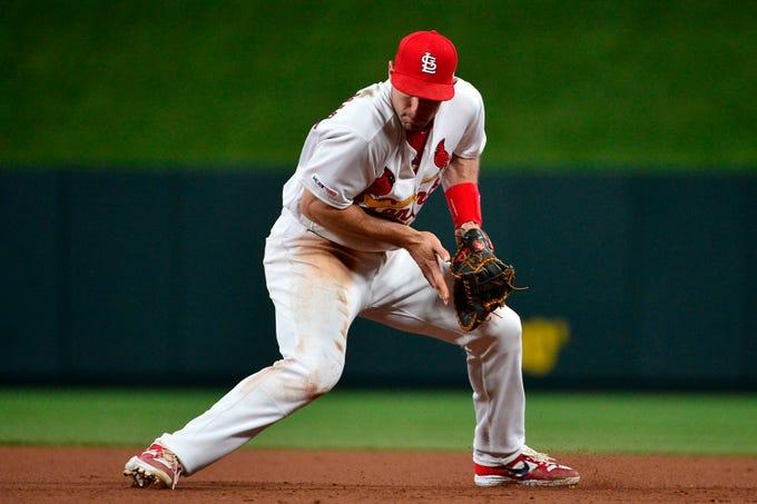 Cardinals first baseman Paul Goldschmidt fields a ground ball hit by Reds center fielder Nick Senzel during a game at Busch Stadium.