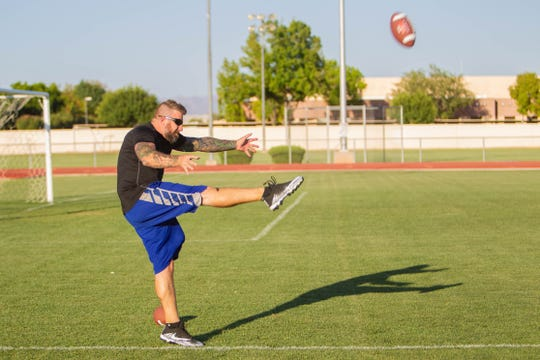 Matthew Edison practices on the Mesa High football field on July 9, 2019.