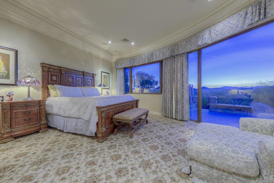 The master bedroom includes mountain views at this Ahwatukee mansion in Phoenix.