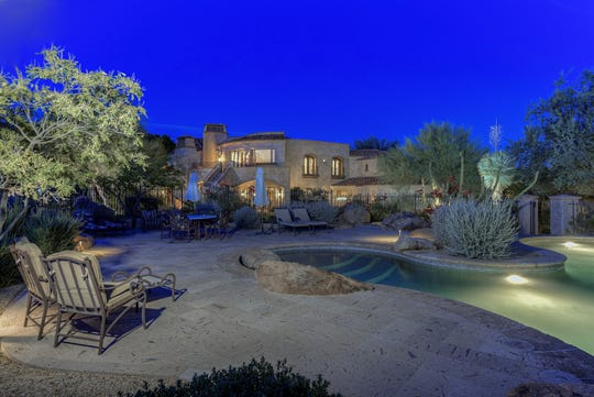 A nighttime view of the pool at an Ahwatukee mansion in Phoenix.