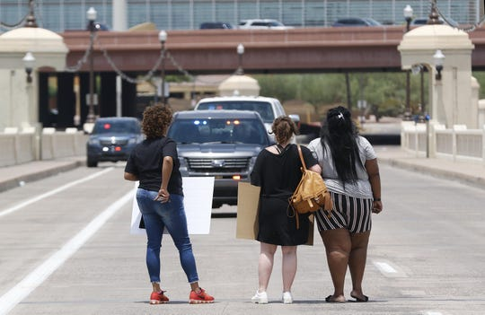 Three women confront Tempe police after refusing to move off the road on the Mill Avenue bridge. The women were with the Rev. Jarrett Maupin and his followers who gathered to protest the police on July 11, 2019.