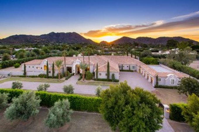 Kenneth Sawyer purchased this mansion at Squaw Peak Estates in Paradise Valley for $5.6M.