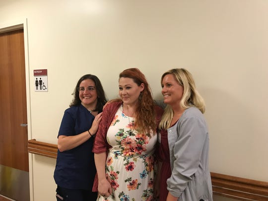 Alicia Conner (left), Meg Nagel-Pete (center), and Brandy Rodriguez (right), stand on the third floor of Good Samaritan Hospital near where Nagel-Pete married her husband, Andy Pete, in May.