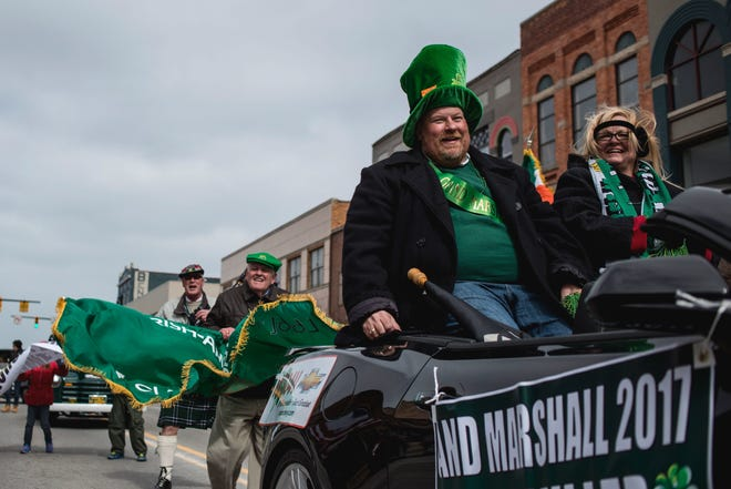 Paul Miller, that year's grand marshal, rides in a convertible during the St. Patrick's Day Parade on Saturday in Port Huron on March 11, 2017