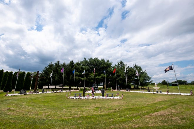 A memorial for lost veterans stands in the front yard of Ron Zuccaro's home on Connell Road, just outside of Yale. He began working on the display about 18 years ago.