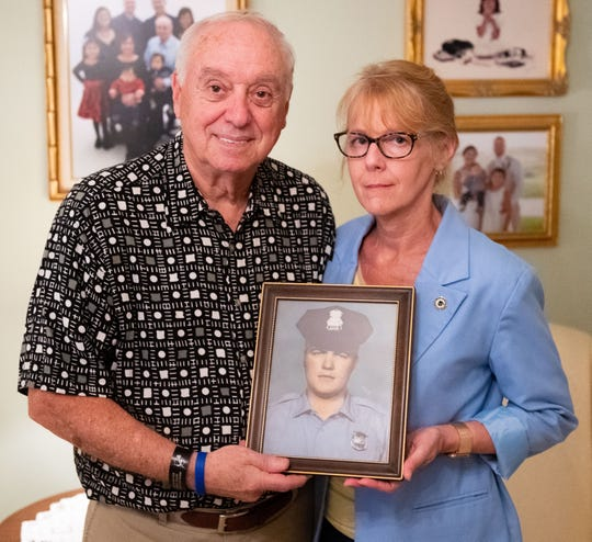 Officer Henry Schaad's brother, Barry, and his daughter, Sharon, hold a picture of Henry, 50 years after he died during the 1969 York riots.