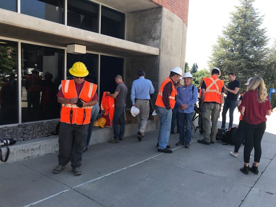 Members of the media await a tour inside the damaged Argenta Hall on Thursday, July 11, 2019.