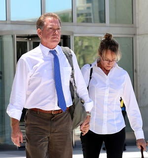 On Wednesday, July 10, 2019, Douglas Haig, left, the Arizona man who sold ammunition to the Route 91 Harvest festival gunman, and his wife, Dori, leave the Lloyd George Federal Courthouse in Las Vegas. A federal judge said a jury will decide if Douglas Haig illegally manufactured bullets sold to the gunman who staged the deadliest mass shooting in the nation's modern history. (Bizuayehu Tesfaye/Las Vegas Review-Journal via AP)