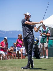 Steph Curry swings during the American Century Championship at Edgewood Tahoe Golf Course on Thursday.
