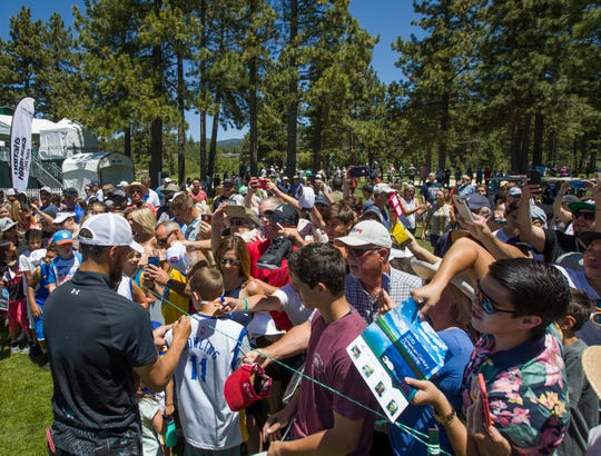 Steph Curry with fans during the American Century Championship at Edgewood Tahoe Golf Course on Thursday.