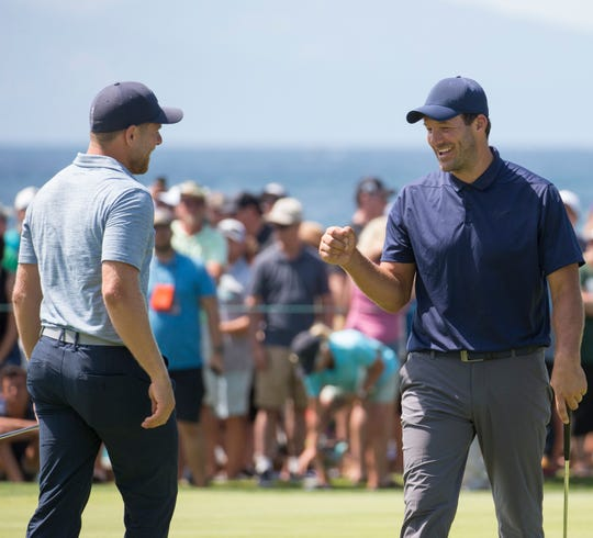 Tony Romo get knuckles from Joe Pavelski after winning the American Century Championship at Edgewood Tahoe Golf Course last year