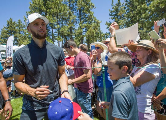Steph Curry with fans during the American Century Championship at Edgewood Tahoe Golf Course in Stateline on Thursday.