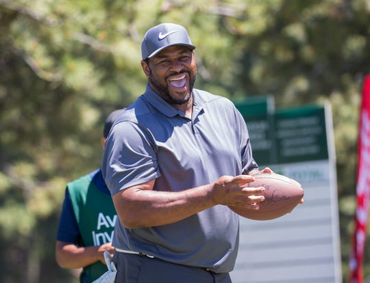Jerome Bettis laughs with fans during the American Century Championship at Edgewood Tahoe Golf Course in Stateline on Thursday.