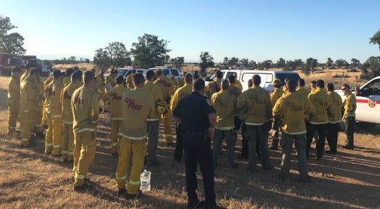 Cal Fire personnel meet Thursday morning, July 11, 2019, at the landfill on Clear Creek Road to prepare for a prescribed burn.