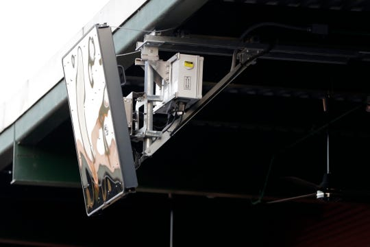 A radar device is seen on the roof behind home plate at PeoplesBank Park during the third inning of the Atlantic League All-Star minor league baseball game, Wednesday, July 10, 2019, in York, Pa. Home plate umpire Brian deBrauwere wore the earpiece connected to an iPhone in his ball bag which relayed ball and strike calls upon receiving it from a TrackMan computer system that uses Doppler radar. The independent Atlantic League became the first American professional baseball league to let the computer call balls and strikes during the all star game.