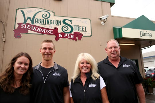 From left, Lauren Hoefler, the operations manager, Adam Hoefler, the general manager, and owners Debi and Glen Conway at the Washington Street Steakhouse & Pub in Dallas on July 10, 2019. The restaurant will hold a 20th anniversary celebration on July 20.