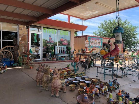 Outside of Gypsy Chix Boutique is range of Mexican imports such as pottery and lawn décor.