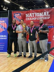 Coaches from the 13U Eastern Shore Aces pose with the national championship trophy on July 8, 2019.