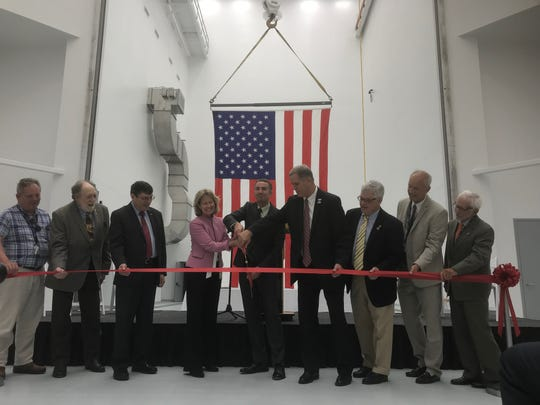 Gov. Ralph Northam and other officials cut a ribbon to officially open a new payload processing facility at NASA Wallops Flight Facility on Wallops Island, Virginia on Thursday, July 11, 2019.
