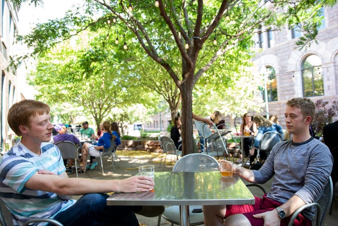 Evan Ward and Troy Hollinsworth drink beer, Wednesday, July 10, while sitting on the Fernson Downtown patio.