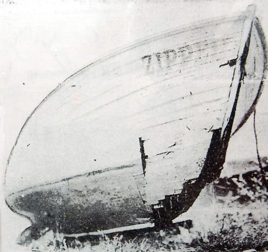 The speedboat Zipper on the beach after the collision with Miss Thriller.