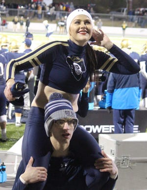 South Dakota School of Mines cheerleaders Karli Fortner and Richard Dennis at a game in Rapid City last season.