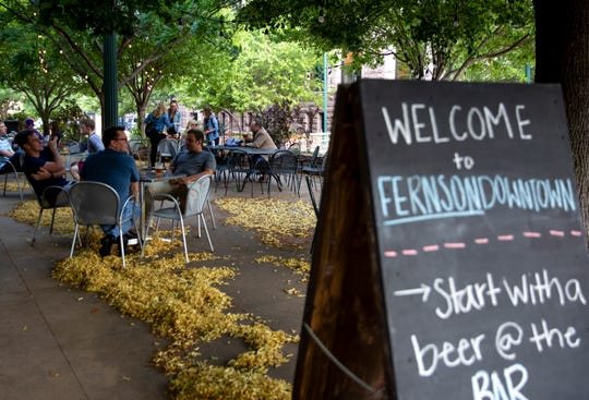 People enjoy beer, Wednesday, July 10, on the Fernson Downtown patio. Fernson Downtown has been open since April 2019 and has 14 beers on tap as well as a wine and cider menu.