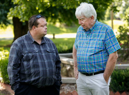 Markus Owens, left, father of Hailey Owens, and Jim Wood, father of Craig Wood, talk before a press conference at Phelps Grove Park, where they discussed Gov. Mike Parson signing Hailey's Law on Thursday.