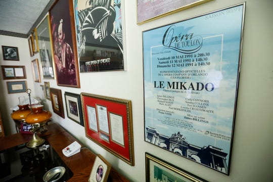 Photographs of James Billings performing in the New York City Opera along with posters of operas he performed in cover the wall at his home in Springfield.