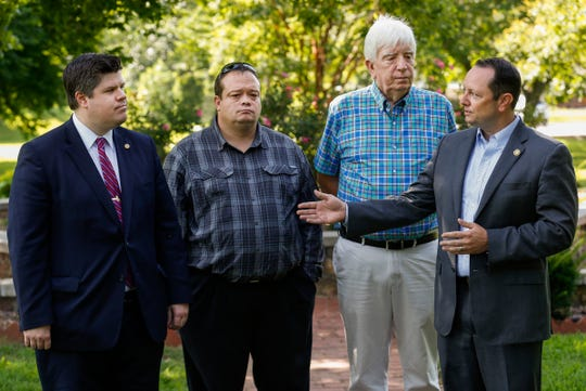 State Sen. Eric Burlison, right, is accompanied by, from left, Rep. Curtis Trent, Markus Owens, the father of Hailey Owens, and Jim Wood, the father of Craig Wood, during a press conference at Phelps Grove Park in Springfield, where they discussed Gov. Parson signing Hailey's Law on Thursday.