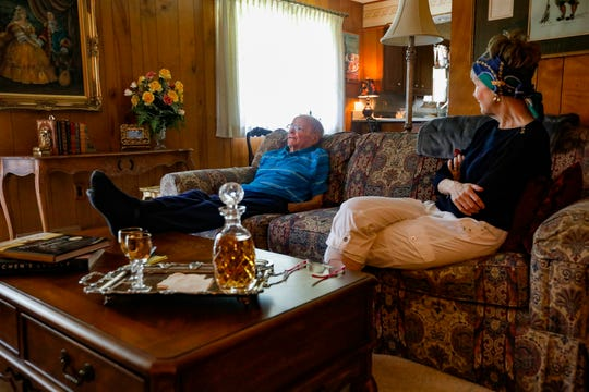 James Billings, left, reflects on his time as a baritone with the New York City Opera as his wife, Judy, listens at their home in Springfield.