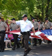 Augusta County Sheriff Donald Smith waves to the crowd during the 2019 July 4th parade in Gypsy Hill Park in Staunton.