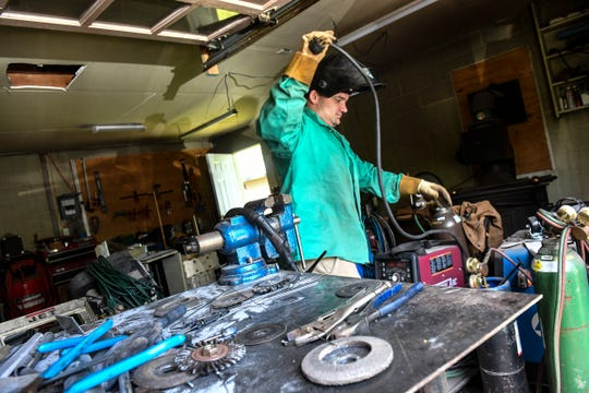 """Mac"" Dhein prepares to weld in his current garage workspace Thursday, July 11, 2019, in St. Cloud. Dhein hopes to create a makerspace in St. Cloud for craftsman and hobbyists."