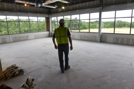 Facilities manager Kevin Korneck walks through a portion of the Stearns County Service Center construction project Wednesday, July 10, 2019, in Waite Park.