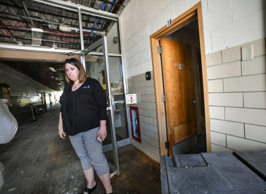St. Elizabeth Ann Seton Catholic School principal Kelly Vangsness pauses while viewing heavy fire damage to the school Friday, July 5, 2019, in St. Cloud.