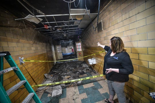 St. Elizabeth Ann Seton Catholic School principal Kelly Vangsness points out damage that occurred to the school after a July 4 fire.