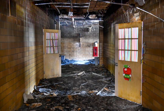 A hallway at St. Elizabeth Ann Seton Catholic School shows heavy fire damage Friday, July 5, 2019, in St. Cloud. A fire was reported in the building just before 6 a.m. Thursday, July 4.