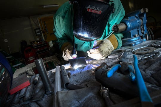 """Mac"" Dhein welds in his garage workspace Thursday, July 11, 2019, in St. Cloud. Dhein hopes to create a makerspace for tradeworkers and hobbyists in St. Cloud."