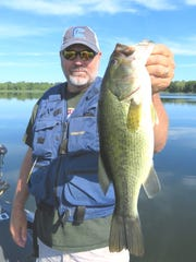 St. Cloud angler Steve Taylor holds a big bass  he hooked while fishing an old favorite lake.
