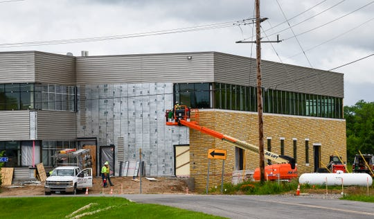 Construction crews work on the exterior of the Stearns County Service Center construction project Wednesday, July 10, 2019, in Waite Park.